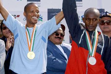 Julius Sugut of Kenya (right) has his arm raised by Hendrick Ramaala of South Africa after the 2004 Mumbai race (AFP/Getty Images)