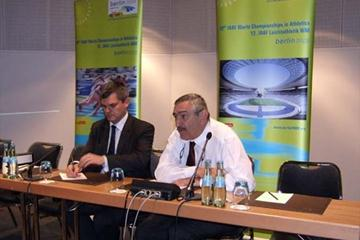 IAAF General Secretary Pierre Weiss (right) delivers a media briefing  after the first day of the IAAF Council in Berlin; left: Nick Davies, IAAF Communications Director (Chris Turner IAAF)