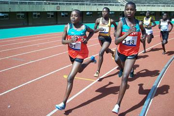 Kenyans Mercy Chebwogen (51) and Edna Chepkemoi and Ugandan Stella Chesang (middle) lead the women's 3000m field during the EAAR Youth Championships at Mandela Stadium, Kampala (Daniel Senfuma)