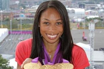 Allyson Felix with collection of London gold (Kirby Lee)