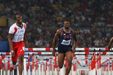 L-R) Liu Xiang of China, Dayron Robles of Cuba, David Oliver of United States and Jason Richardson of United States compete in the men's 110 metres hurdles final (Getty Images)