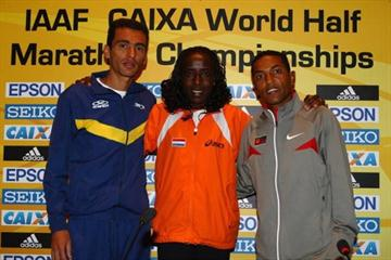 (L-R) Marilson Gomes dos Santos of Brazil, Lornah Kiplagat of the Netherlands and Zersenay Tadese of Eritrea pose during a press conference for the IAAF Caixa World Half Marathon Championships (Getty Images)