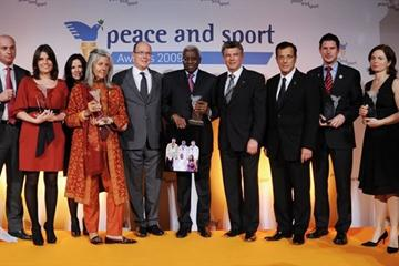 President Lamine Diack centre stage at the Peace and Sport Forum in Monaco to his immediate left, Joël Bouzou, President and Founder of Peace and Sport, and to his immediate right, H.S.H. Prince Albert II of Monaco (c)