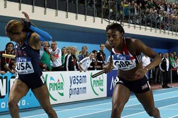 Perri Shakes-Drayton of Great Britain crosses the line ahead of Sanya Richards-Ross of the United States to win gold in the Women's 4x400 Metres Final during day three - WIC Istanbul (Getty Images)