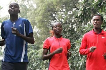 Kenyans Sammy Kitwara and Lucy Kabuu, along with Feyisa Lelisa of Ethiopia limbering up in preparation for the Airtel Delhi Half Marathon (Airtel Delhi Half Marathon Organisers)