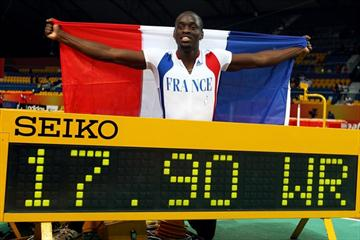 Teddy Tamgho of France with World indoor record scoreboard in Doha (Getty Images)