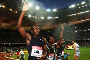 Usain Bolt goes on a victory lap after emphatically winning the men's 100m in 9.79 (Getty Images)