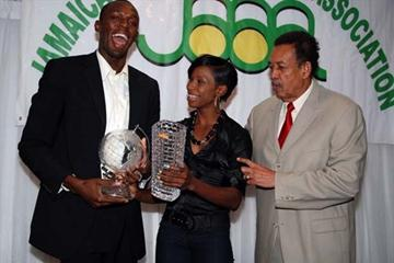 Usain Bolt (left) and Melaine Walker (centre) pose with JAAA President Howard Aris after receiving their Male and Female of the Year awards (Anthony Foster)