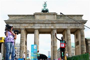 Abel Kirui of Kenya crosses the finish line at the Bradenburg Gate in Berlin to win the gold in the men's Marathon with a Championship Record (Getty Images)
