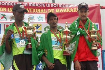 Marrakech Marathon top three - winner Girma Beyene Gezahn (c), runner-up Shumi Gerbaba Etisha (l), Mourad Maarofit (r) (Organisers)