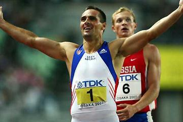 Sebrle crosses the finish of the 1500m to win the Decathlon (Getty Images)