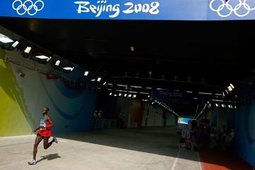 Eventual winner Samuel Wanjiru enters the stadium at the end of the Olympic marathon (Getty Images)