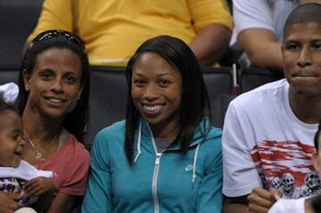 Allyson Felix with Joanna Hayes and Kenneth Ferguson at Los Angeles Sparks WNBA game (Kirby Lee)