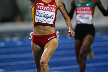 Marta Dominguez of Spain crosses the line to win the gold medal in the women's 3000m steeplechase at the 12th IAAF World Championships in Athletics (Getty Images)