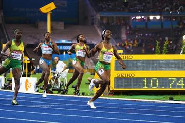 Shelly-Ann Fraser of Jamaica crosses the line to celebrates winning the women's 100m gold medal at the 12th IAAF World Championships in Athletics (Getty Images)