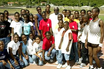 IAAF President Lamine Diack with some of the children at the IAAF Training Clinic in Kingston (IAAF)
