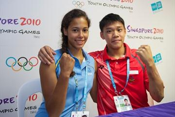 Angelica Bengtsson with Timothy Tay Kai Cheng, the flag bearer for Singapore in the YOG Opening Ceremony (Volker Minkus)