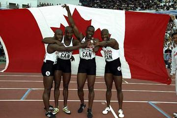 Canada's winning 1995 World Champs squad celebrate - Robert Esmie (left), Donovan Bailey (second left), Bruny Surin (second right) and Glenroy Gilbert (right), (Getty Images)