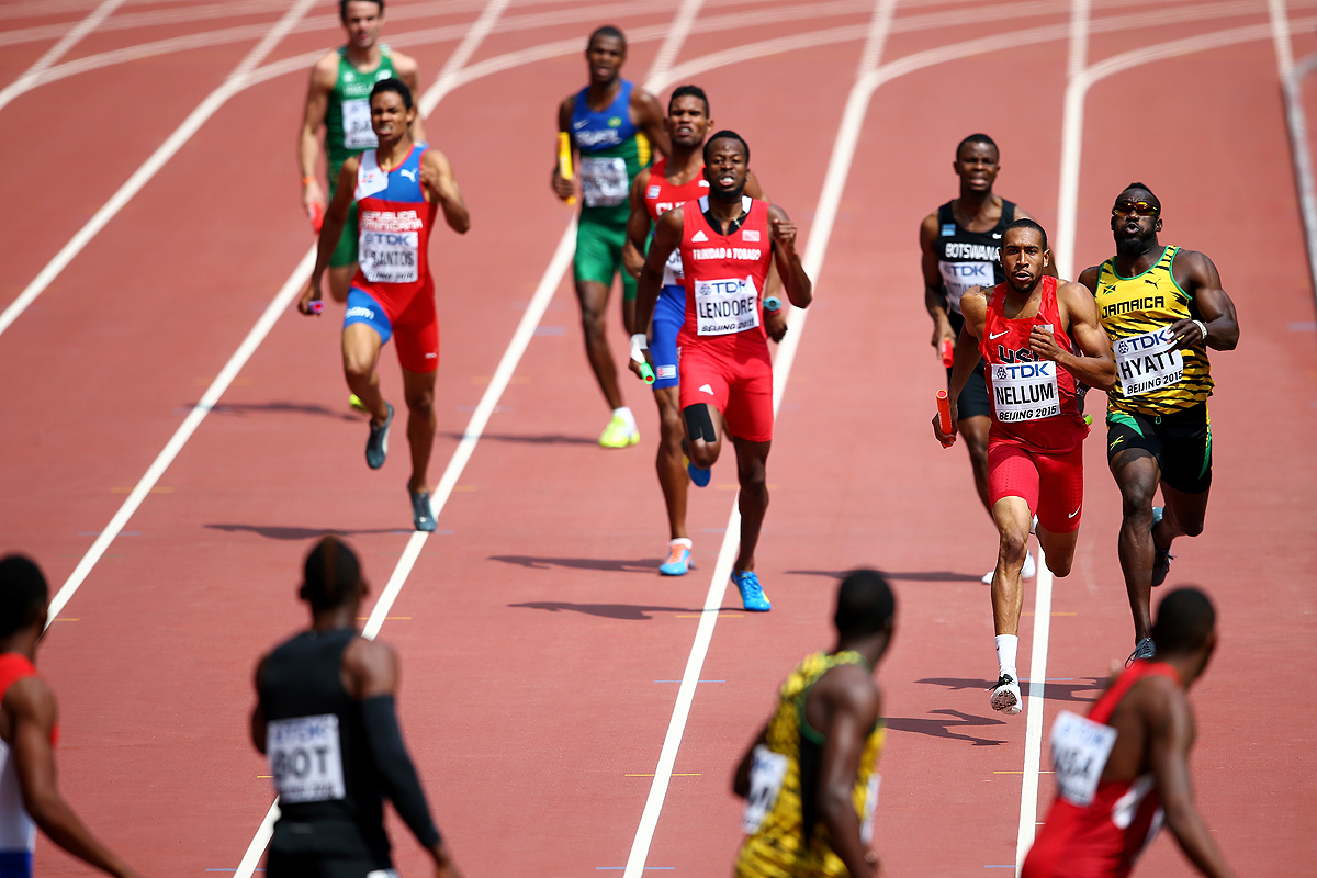Athletes heading for the changeover in the men's 4x400m heats at the IAAF World Championships Beijing 2015 (Getty Images)