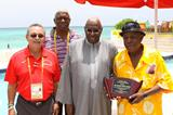 NACAC President Victor Lopez (left) and IAAF President Lamine Diack (centre) present plaques to Bahamian sports journalists (CASJA / Patrick Hanna)