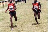 Richard Limo holds off Paul Kimugul in the 12km at the regional XC champs (Okoth)