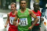 Michael Rotich (right) runs to the side of eventual World champion Jaouad Gharib in Paris 2003 - Rey (ESP) is on the left (Getty Images)