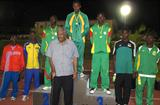 """Premier Ralph T. O'Neal who threw his support behind the BVI Athletics Association's hosting of the XIV CAC Age Group Championships, poses with the 13-14 Boys Shot Putters after presenting them with awards (Dean """"The Sportsman"""" Greenaway )"""