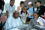 IAAF President Lamine Diack assisted by Marie-José Pérec at the IAAF Outreach Programme in Beijing (Getty Images)