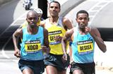 Lelisa Desisa leads from Micah Kogo and Gebre Gebremariam in the 2013 Boston Marathon (Victah Sailor)