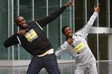 Usain Bolt and Haile Gebrselassie in a wet Manchester ahead of Sunday's competitions (Getty Images)