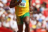 Usain Bolt cruises through the first round of the 100m in Beijing (Getty Images)