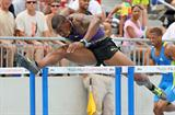David Oliver en route to his PB 12.93 victory in Des Moines (Getty Images)