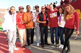 Allyson Felix (2nd from right) with fellow Olympians at the USC Homecoming football game (Kirby Lee)