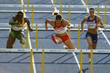 (L-R) Delloreen Ennis-London of Jamaica, Priscilla Lopes-Schliep of Canada and Cindy Billaud of France compete in the women's 100m hurdles semi-final in Berlin (Getty Images)