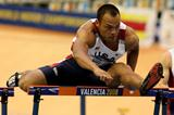Bryan Clay powers to victory in the heptathlon 60m hurdles (Getty Images)