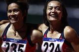 Wal Punsoongneun (R) and Wassana Wunatho (L) of Thailand celebrate their Gold and Bronze medal places respectively in the Womens 100m Hurdles Final on day three of the 2011 Southeast Asian Games at Jakabaring Sports Complex on 13 November 2011 in Palembang, Sumatra, Indonesia (Getty Images)