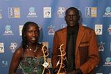 Florence Kiplagat and Dennis Kimetto with their 2014 AIMS Best Marathon Runner Awards (AIMS / Francis Kay - Marathon-Photos.com)