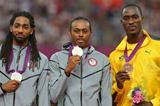 (L-R) Silver medalist Jason Richardson of the United States, gold medalist Aries Merritt of the United States and bronze medalist Hansle Parchment of Jamaica pose on the podium during the medal ceremony for the Men's 110m Hurdles  of the London 2012 Olympic Games  on August 9, 2012  (Getty Images)