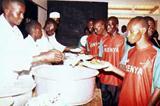 Charles Kamathi, Sammy Kipketer, Shadrack Kosgei and David Chepterit queue for the lunch (Okoth)