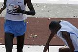Paul Tergat wins the ING New York Marathon as defending champion Hendrick Ramaala falls to the ground (Getty Images)