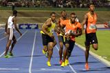 Yohan Blake (yellow vest) collects the baton behind Edino Steele at the 2013 Gibson Relays  (Anthony Foster)