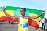 Dereje Debele celebrates his victory and course record at the Dusseldorf Marathon (Victah Sailer)