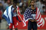 Jason Richardson looks on, Dayron Robles is disqualified by the track referee after winning the 110m Hurdles final in Daegu (Getty Images)
