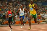 Usain Bolt dwarfs the opposition in the 200m quarter finals (Getty Images)