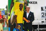 Jamaica's Usain Bolt is given a piece of the Berlin Wall by the Mayor of Berlin Klaus Wowereit for his achievements at the 12th IAAF World Championships in Athletics (Getty Images)