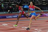 Natalya Antyukh of Russia crosses the finish line ahead of Lashinda Demus of the United States in the Women's 400m Hurdles Final on Day 12 of the London 2012 Olympic Games on 8 August 2012 (Getty Images)