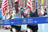 Dejen Gebremeskel out-sprints Ben True to take the 5km win in Boston (Victah Sailer)