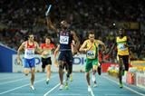 LaShawn Merritt of the USA crosses the finish line ahead of L.J. van Zyl of South Africa to claim victory in the men's 4x400 metres relay final (Getty Images)