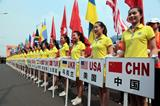 Volunteers with the name of participating countries at the opening ceremony of IAAF World Race Walking Cup Taicang 2014 (Kevin Lee)