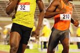 Usain Bolt crosses the line in his usual confident style after winning the 2009 Jamaican 100m title (Anthony Foster)
